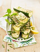 Grilled zucchinis with lemon and mint