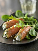 Smoked salmon rolls stuffed with ricotta and herbs