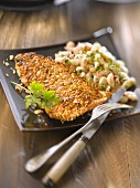 Trout fillet in cereal crust, white bean salad
