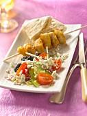 Grilled chicken brochette , Greek salad and pitta