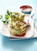 Individual zucchini Flans with tomato puree
