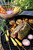 Roasted loins of lamb with cilantro and grilled vegetable brochettes