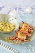 Scallop and bacon brochette with white butter sauce