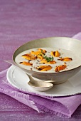 Cream of celeriac soup with mussels and 5 peppers