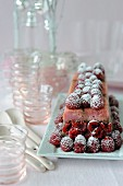 Chocolate-raspberry and pink biscuit ice cream log cake
