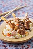 Chicken brochettes with cantonese rice