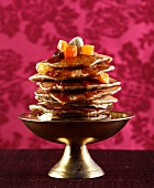 Baghrirs,small pancakes with honey and dried fruit