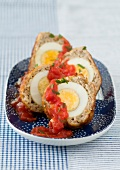 Scotch eggs with tomato sauce