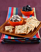 Parmesan shortbread cookies and cream of black olives