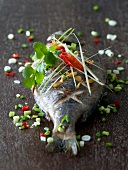 Baked sea bream with scallion,cilantro and chili peppers