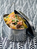 Fried rice with shrimps, omelette strips, mushrooms and peas in a tin