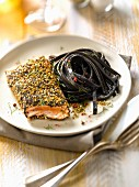 Salmon steak in sesame and poppy seed crust,squid ink spaghettis