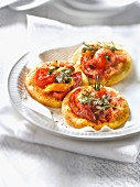 Cherry tomato, pancetta and grilled pepper mini pizzas
