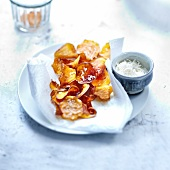 Sweet potato crisps sprinkled with grated coconut