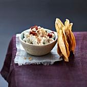 Ricotta and sun-dried tomato mousse,buckwheat crisps