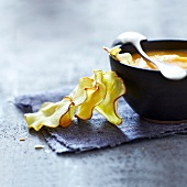 Cream of carrot soup with parsnip crisps