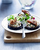 Sliced eggplants grilled with goat's cheese and fresh figs