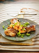 Chicken wings with crayfish and spring onions