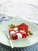 Checkered strawberry jelly cubes and white marshmallow cubes