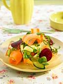 Cucumber, carrot, and sliced beetroot salad
