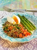 Stewed lentils and tomatoes, soft-boiled egg and green asparagus