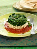 Basmati rice and spinach timbale with tomato sauce