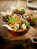 Spinach, blue cheese and walnut salad