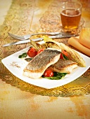 Grilled sea bream fillets with chicory, spinach and cherry tomatoes