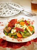 Cooked vegetable salad with spanish ham