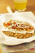 Goat's cheese, tomato and beansprout open sandwich