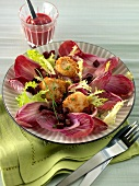 Deep-fried breaded cheese bites with red chicory