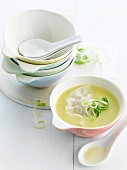 Cream of asparagus soup with fish ravioli