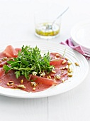 Beef carpaccio with blue cheese and pine nuts