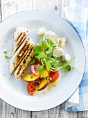 Grilled chicken breast with nectarines,tomatoes, potato and mayonnaise salad