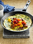 Herb omelette with cherry tomatoes