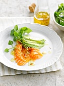 Spicy salmon carpaccio with avocado and watercress