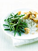 Chicken with groundnut sauce,basmati rice and green beans