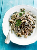 Wholemeal pasta with mushrooms and diced bacon