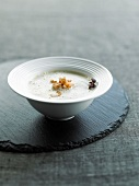 Cream of chicory soup with shrimps
