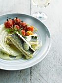 Salt bass cooked in salt crust,foamy lemon sauce,mashed potatoes and cherry tomatoes