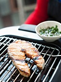 Cooking a salmon steak on an electric barbecue
