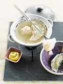 Wonton raviolis fondue
