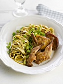 Roast quail and tagliatelles with spring onions