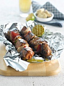 Beef brochettes with anchovy butter