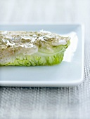 Bass and lettuce bite sprinkled with green tea powder