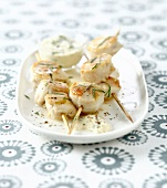 Scallop brochettes with white butter sauce and cilantro
