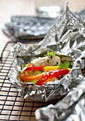 Oriental-style steamed rabbit cooked in aluminium foil