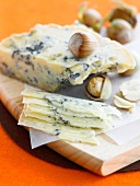 Thinly sliced blue cheese with hazelnuts