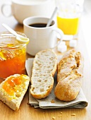 Breakfast with coffee,orange juice ,bread and jam