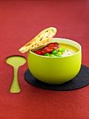 Cream of pea soup with chorizo